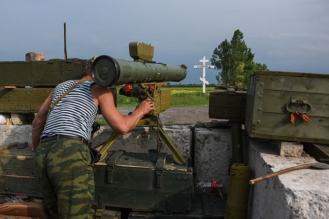 A_Russia-backed_rebel_guards_his_position_near_the_division_line_with_Ukrainian_army_with_anti-tank_missile-near_Dokuchaevsk,_eastern_Ukraine,_Friday,_June_5,_2015